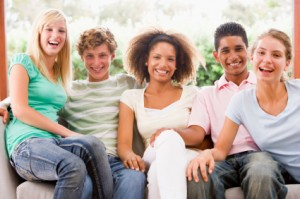Group Of Teenagers Sitting On A Couch
